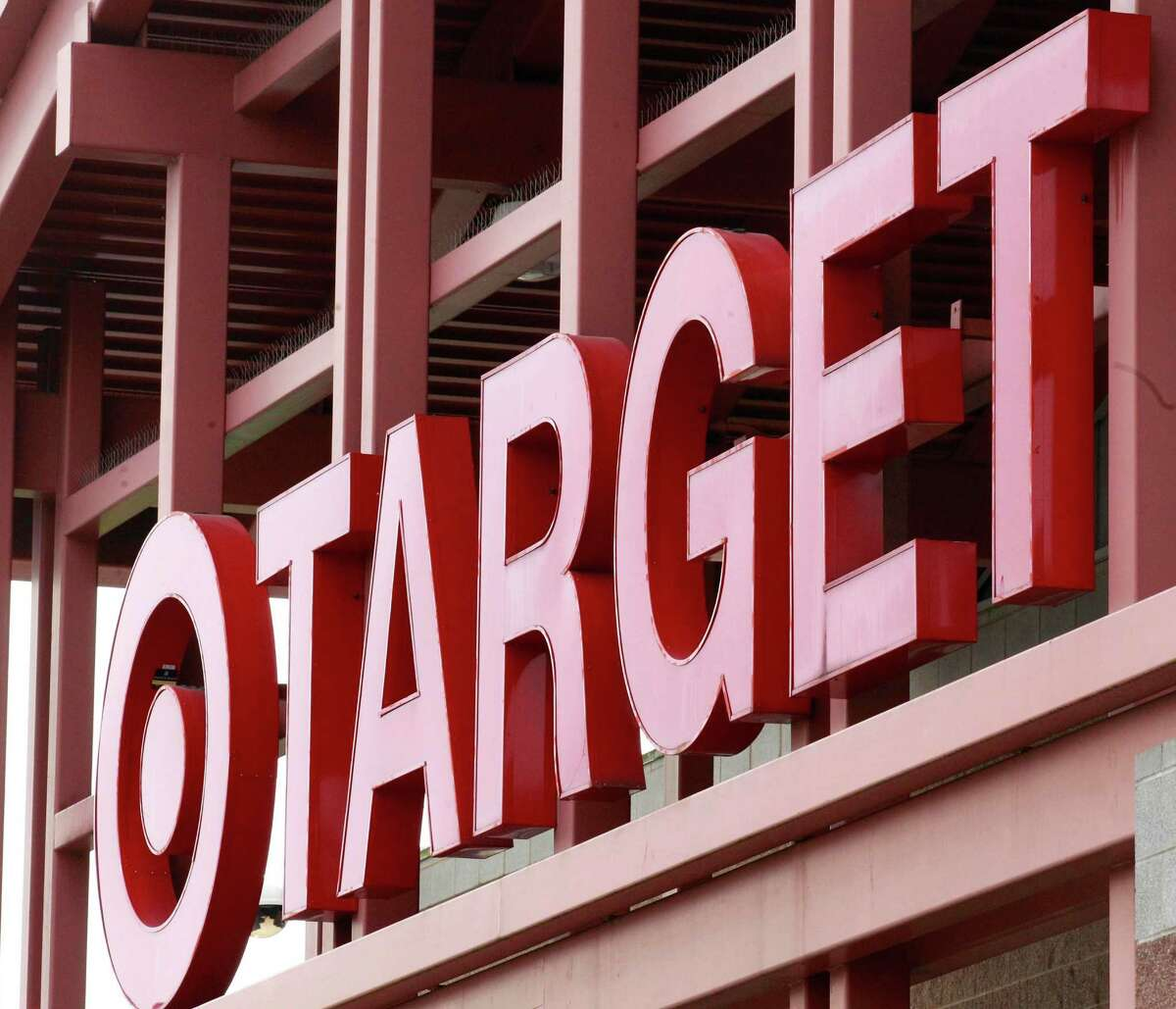 FILE - This Tuesday, May 17, 2011, file photo, shows a Target sign on the front of a Target Store, in Wilsonville, Ore. Target announced Monday, June 15, 2015, that it is selling its pharmacy and clinic businesses to the drugstore chain CVS Health for about $1.9 billion in a deal that combines the resources of two retailers seeking to polish their reputations as health care providers. (AP Photo/Rick Bowmer, File)
