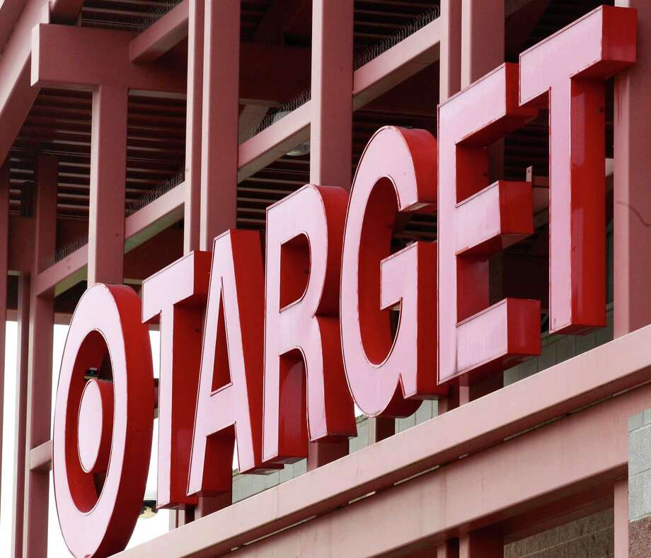 FILE - This Tuesday, May 17, 2011, file photo, shows a Target sign on the front of a Target Store, in Wilsonville, Ore. Target announced Monday, June 15, 2015, that it is selling its pharmacy and clinic businesses to the drugstore chain CVS Health for about $1.9 billion in a deal that combines the resources of two retailers seeking to polish their reputations as health care providers. (AP Photo/Rick Bowmer, File) Photo: Rick Bowmer, STF / AP