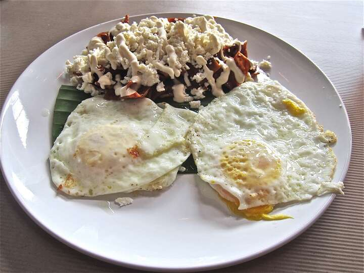 Chilaquiles with fried eggs at Cuchara. Photo-8155512.111680 - Houston ...