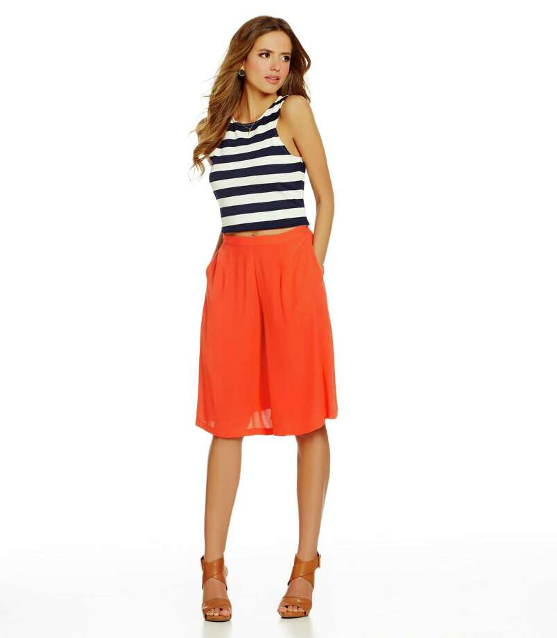 1. Throwback culottes With a nod to 1960s flair, this nostalgic and roomy pant that hangs like a skirt is a terrific alternative to a sundress or jumpsuit. Whatever color, fabric and print (stripes to tropical), team the culotte with a fitted or cropped top (remember opposites attract when it come to proportions) and anchor the look with sandals or flats for a casual look. Or dress up the look with pointy pumps. But stay away from high-strapped shoes like gladiators that will undermine an elongated silhouette. If you're petite, select a culotte with a shorter hemline, also for a leaner look. Pictured:  Gianni Bini culotte, $27.65, Nicole Miller stripe crop top, $210, Dillard's. Photo: Courtesy Dillard's