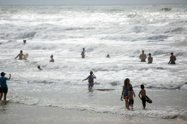 Beach goers play in the Gulf of Mexico Monday, June 15, 2015, in Galveston, Texas. With Hurricane Carlos off the Mexican coast, The Galveston County Office of Emergency Management has issued a voluntary evacuation order. (Cody Duty / Houston Chronicle via AP Mandatory Credit)
