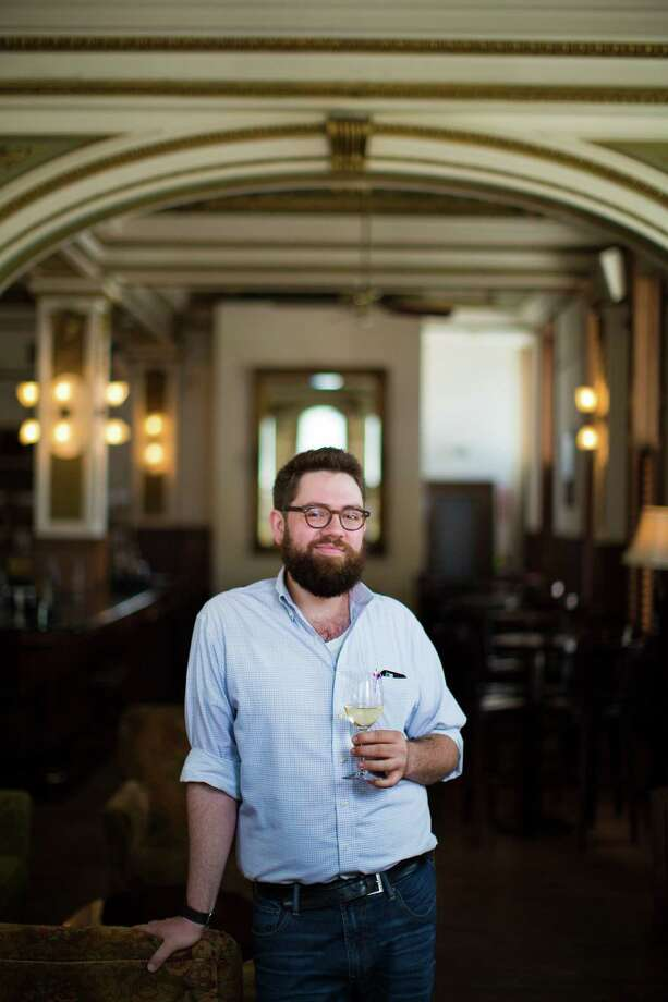 Justin Vann, co-owner of Public Services Wine & Whiskey curates the large selection of wines and whiskeys. The bar is located in the historic Old Cotton Exchange Building in Downtown Houston. Wednesday, June 10, 2015, in Houston. ( Marie D. De Jesus / Houston Chronicle ) Photo: Marie D. De Jesus, Staff / © 2015 Houston Chronicle