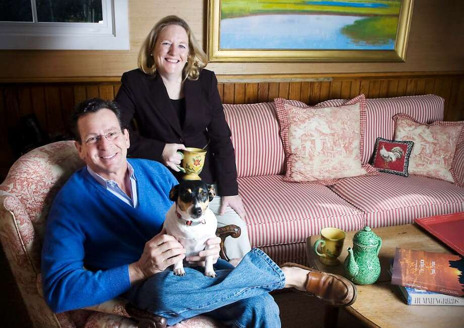 Former Stamford Mayor Dannel Malloy and his wife Cathy Malloy sit with their Jack Russell Terrier Zoe in their family room in their home in Stamford, Conn. on Wednesday, March 10, 2010. Malloy is a Democratic gubernatorial candidate. Photo: Kathleen O'Rourke / Stamford Advocate