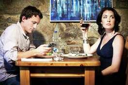 Bored couple having dinner in restaurant
