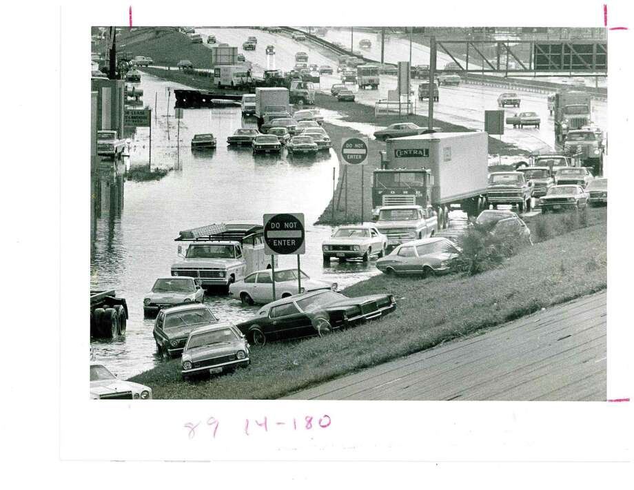 """Images from the 1976 floods that resulted in the only """"rain out"""" in Astrodome history. The game between the Astros and Pittsburgh Pirates on June 15, 1976 was postponed after fans, umpires and other stadium personnel couldn't enter the stadium due to flooding around the Astrodome's entrances. Photo: Houston Chronicle"""