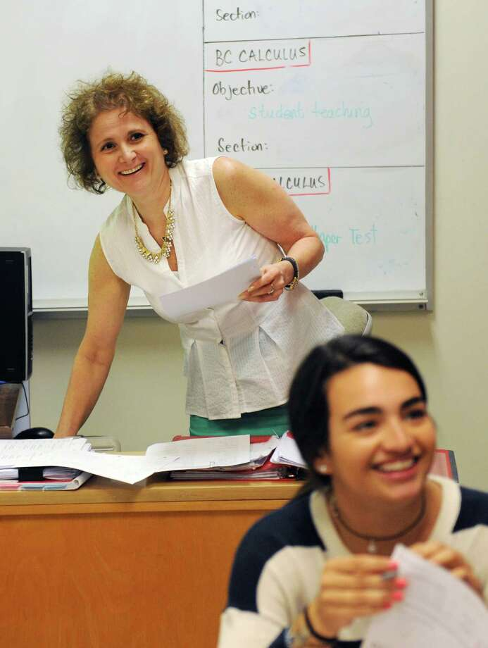 Calculus teacher Maryann Franchella laughs during her mixed-grade pre-calculus class at Greenwich High School in Greenwich, Conn. Thursday, June 4, 2015.  Franchella was awarded one of the six Greenwich School District Distinguished Teacher Awards for 2015. Photo: Tyler Sizemore / Tyler Sizemore / Greenwich Time