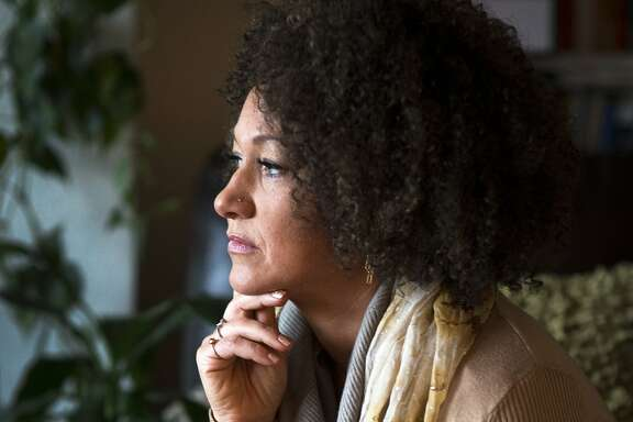 FILE - In this March 2, 2015, file photo, Rachel Dolezal, president of the Spokane chapter of the NAACP, poses for a photo in her Spokane, Wash., home. Dolezal resigned Monday, June 15, 2015, amid a furor over racial identity that erupted when her parents came forward to say she has been posing as black for years when she is actually white. (Colin Mulvany/The Spokesman-Review via AP, File)