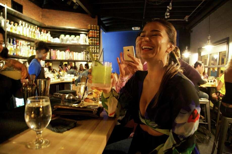 Giovanna Gonzakez is at Mezcalería Mixtli. Photo: Xelina Flores / / For the Express News