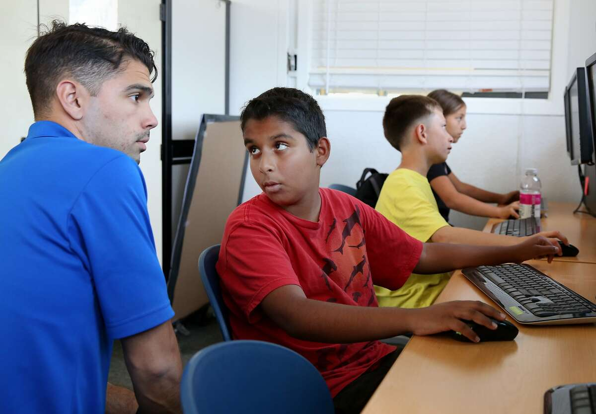 Technology coordinator Josh Cowen (left) listened to questions from his class during the Roblox demo Monday June 15, 2015. San Mateo video game company Roblox is launching a pilot program with the Mid-Peninsula Boys and Girls club to teach kids how to code and create their own video games.
