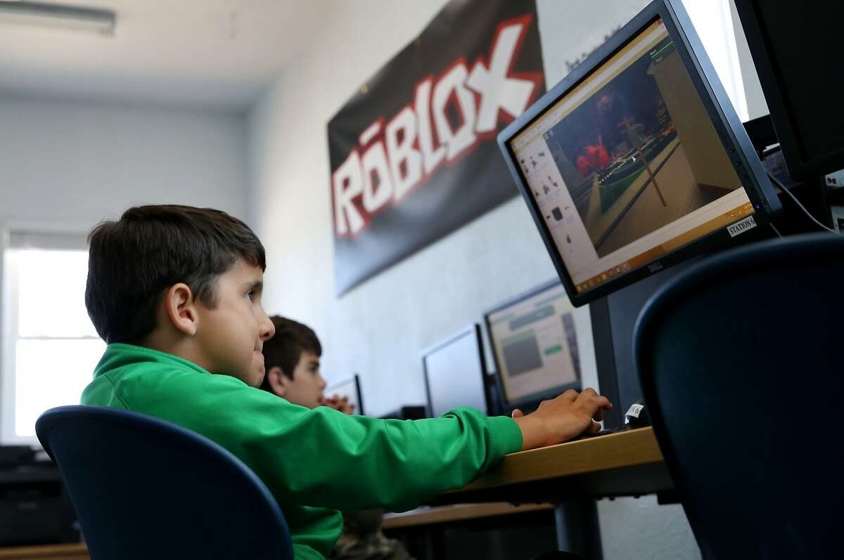 Walter Romero looked determined as he constructed his game Monday June 15, 2015. San Mateo video game company Roblox is launching a pilot program with the Mid-Peninsula Boys and Girls club to teach kids how to code and create their own video games.