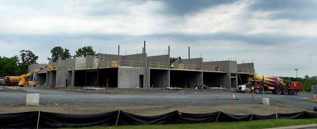 An exterior view of the new TownePlace by Marriott hotel under construction Friday afternoon June 12, 2015 on Forts Ferry Road in Latham, N.Y.     (Skip Dickstein/Times Union) Photo: SKIP DICKSTEIN / 00032264A