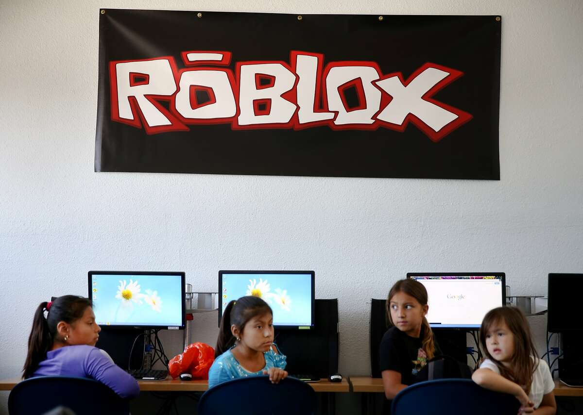 A group of young girls watched the presentation for making video games on Roblox Monday June 15, 2015. San Mateo video game company Roblox is launching a pilot program with the Mid-Peninsula Boys and Girls club to teach kids how to code and create their own video games.
