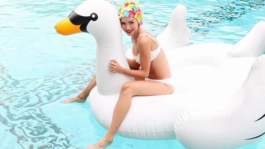 Pick up a mega-size swan and smiley face floaties, among other items, at Pop-In@Nordstrom Goes Poolside, at locations including the San Francisco store. Photo: Nordstrom