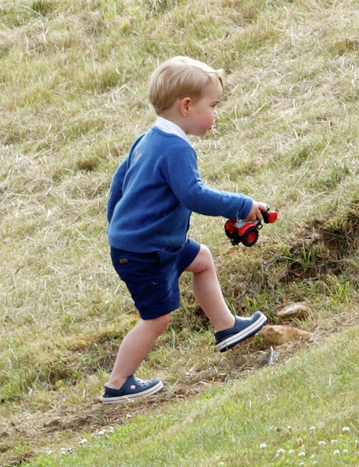 Prince George of Cambridge wears navy Crocs to the Gigaset Charity Polo Match at the Beaufort Polo Club on June 14, 2015 in Tetbury, England. Photo: Max Mumby/Indigo, Getty Images / 2015 Max Mumby/Indigo