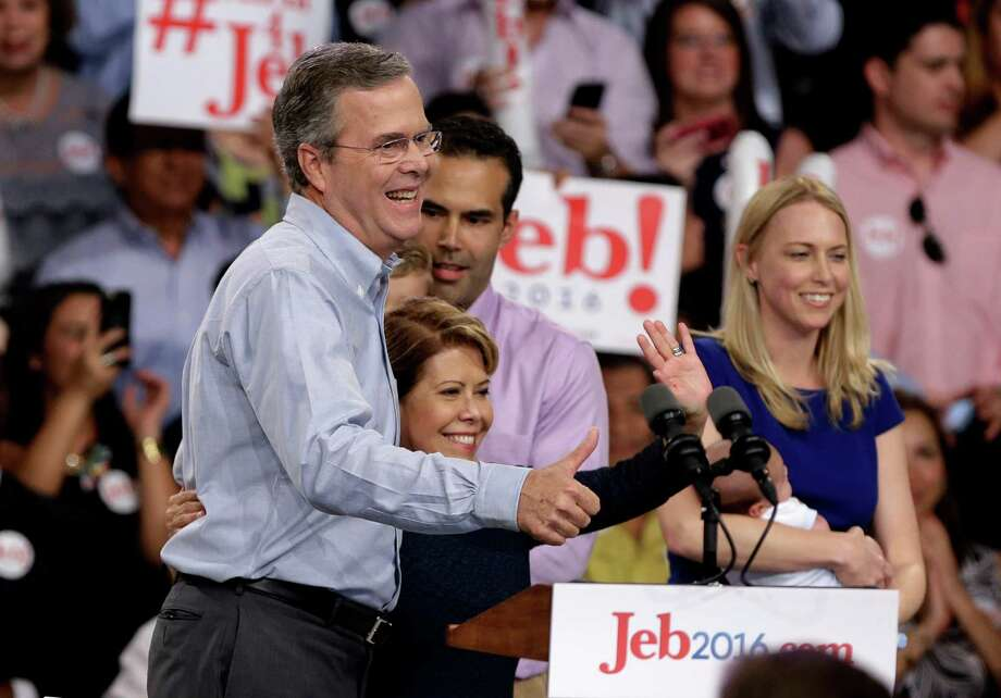 Former Florida Gov. Jeb Bush with his wife, Columba, and other family members, gives a thumbs-up after announcing his bid. Photo: Lynne Sladky /Associated Press / AP