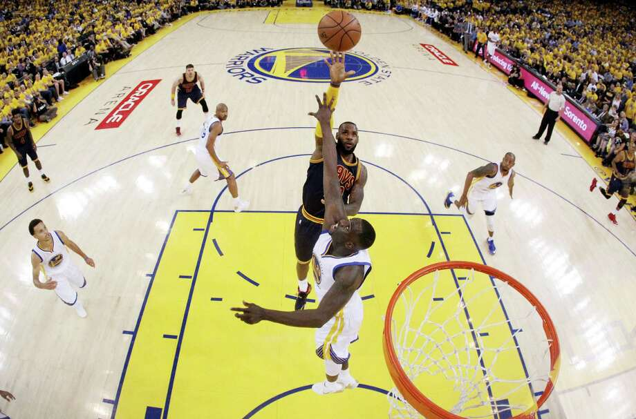 OAKLAND, CA - JUNE 14:  LeBron James #23 of the Cleveland Cavaliers goes up against Draymond Green #23 of the Golden State Warriors in the first half during Game Five of the 2015 NBA Finals at ORACLE Arena on June 14, 2015 in Oakland, California. NOTE TO USER: User expressly acknowledges and agrees that, by downloading and or using this photograph, user is consenting to the terms and conditions of Getty Images License Agreement.  (Photo by Ezra Shaw/Getty Images) Photo: Ezra Shaw, Staff / 2015 Getty Images