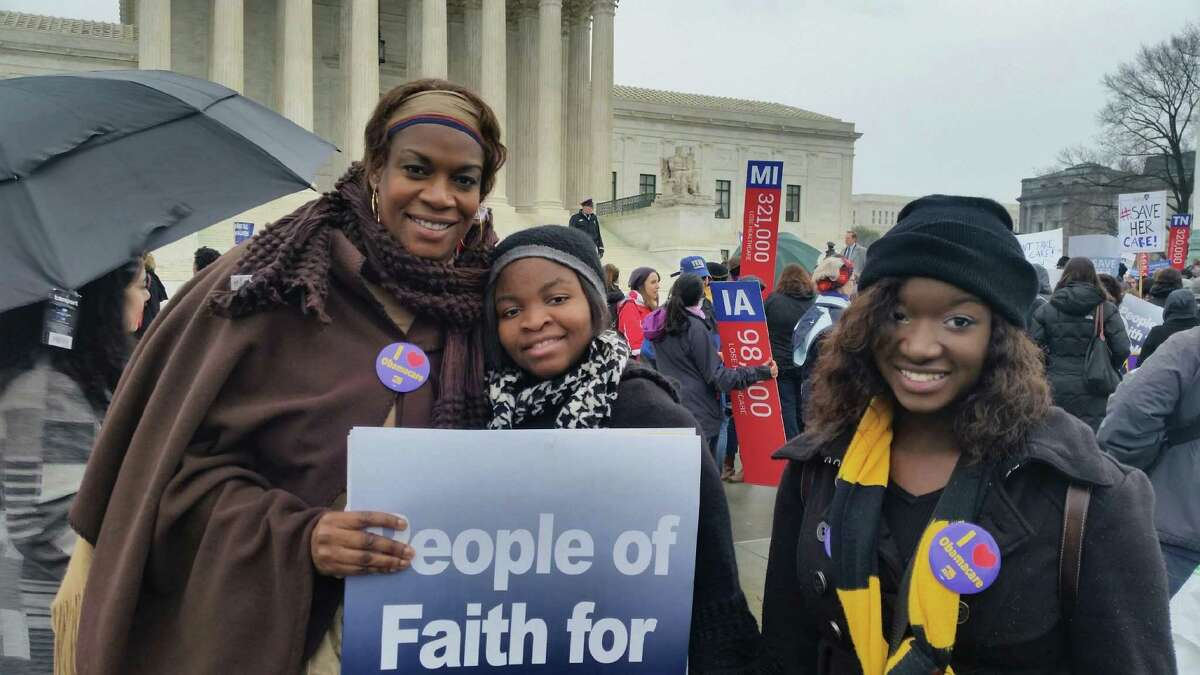 Claudette Newsome of Houston and her daughters, Zoe and Alexandria, traveled to Washington D.C. to rally March 4 in front of the Supreme Court. The justices heard oral arguments in King v. Burwell, the lawsuit challenging whether millions of people who bought health insurance through the federal marketplace are entitled to subsidies.