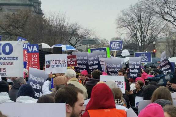 Supporters and opponents of the Affordable Care Act and its federal subsidies rally March 4 in Washington D.C. as the Supreme Court hears oral arguments in King v Burwell, the lawsuit challenging the subsidies in the federal health insurance marketplace.