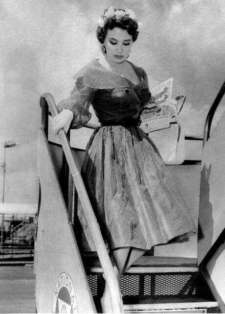 Burlesque icon Blaze Starr steps off a plane in 1959 to visit Louisiana Gov. Earl K. Long. Photo: STF / AP