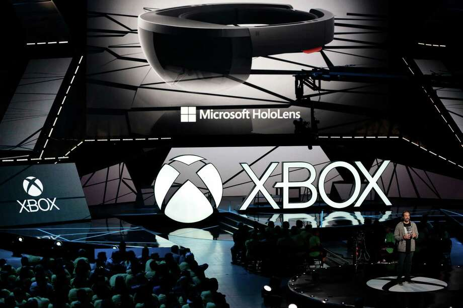 """The Microsoft HoloLens is showcased at the Xbox E3 2015 briefing ahead of the Electronic Entertainment Expo (E3) at the University of Southern California's Galen Center on Monday, June 15, 2015 in Los Angeles. Microsoft is promoting the next installment in its popular sci-fi franchise, """"Halo 5: Guardians,"""" at the Electronic Entertainment Expo. (AP Photo/Damian Dovarganes) Photo: Damian Dovarganes, STF / AP"""