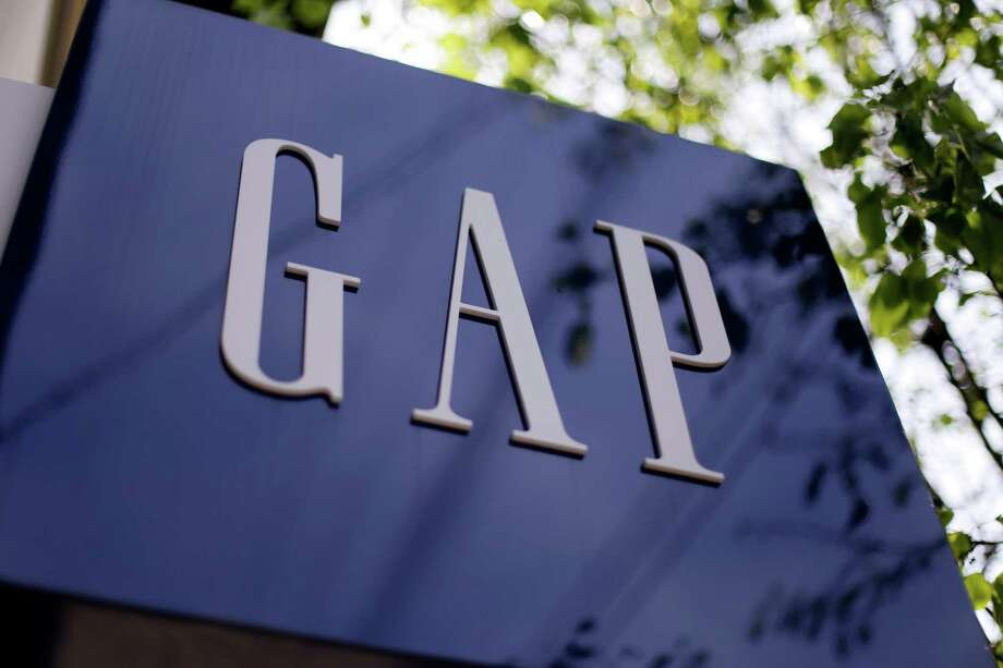 This photo taken on May 14, 2014, shows signage outside a Gap store in the Shadyside section of Pittsburgh. The Gap Inc. reports quarterly financial results after the market closes Thursday, May 21, 2015. (AP Photo/Gene J. Puskar) Photo: Gene J. Puskar, STF / AP