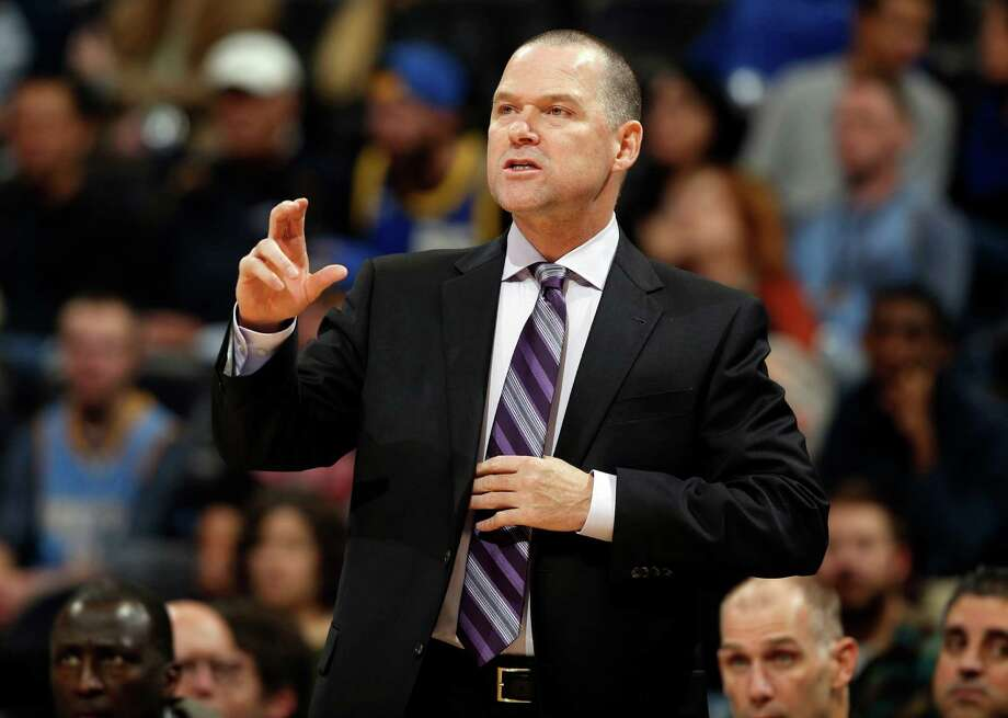 FILE - In this photo taken Nov. 3, 2014, Sacramento Kings coach Michael Malone directs his team against the Denver Nuggets in the first quarter of an NBA basketball game in Denver.  A person familiar with the decision says the Denver Nuggets have reached an agreement to make Malone their new coach. The person spoke to The Associated Press on condition of anonymity Monday, June 15, 2015, because the hiring has yet to be announced. (AP Photo/David Zalubowski, File) Photo: David Zalubowski, STF / AP