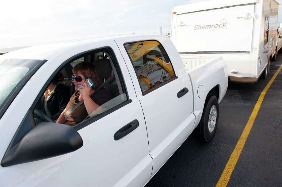 Sharon Wisniewski sits with her trailer in tow on the Galveston-Port Bolivar ferry on Monday after picking it up from an R.V. park on Bolivar Peninsula when she heard about flooding risks from the incoming tropical weather. Photo: Alysha Beck, Freelance / Houston Chronicle