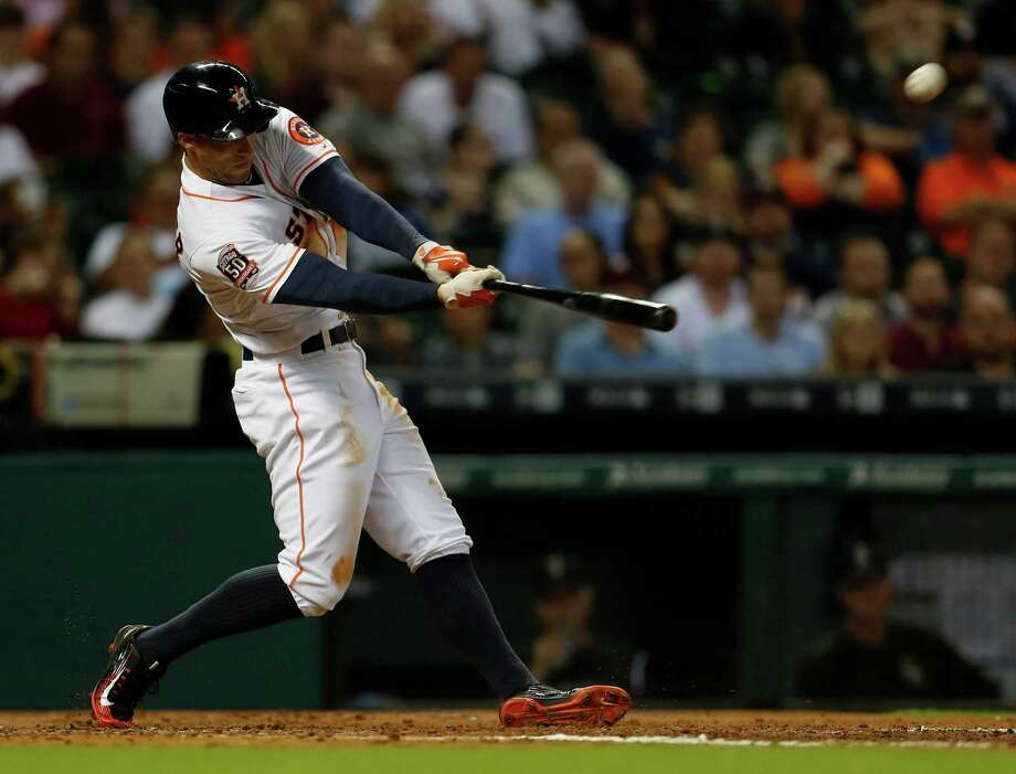 Part of George Springer's approach at the plate includes keeping his bat in the strike zone longer as he becomes more selective. Photo: Karen Warren, Staff / © 2015 Houston Chronicle