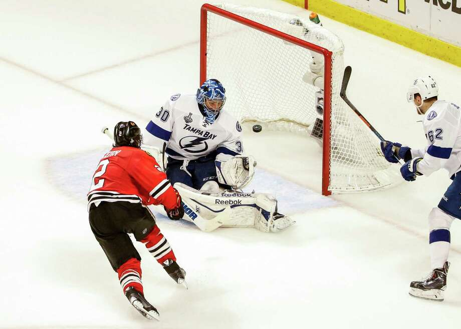 Chicago defenseman Duncan Keith (2) puts the puck past Tampa Bay goalie Ben Bishop (30) to give the Blackhawks a 1-0 lead in the second period of Game 6 of the Stanley Cup Final on Monday night. Photo: Dirk Shadd, MBR / Tampa Bay Times