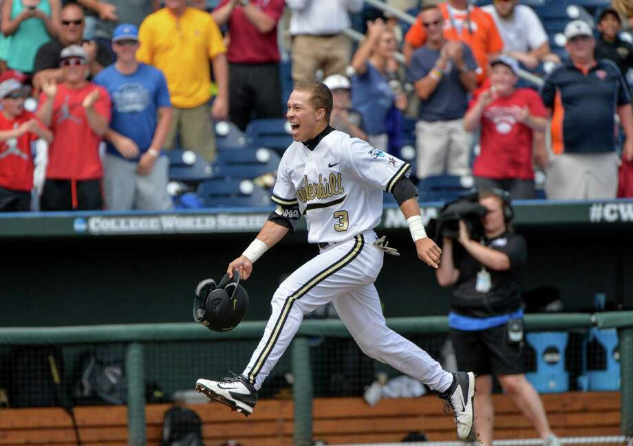 Tyler Campbell heads for home after hitting a game-winning two-run homer in the ninth inning to give Vanderbilt a 4-3 victory over Cal State-Fullerton. Photo: Ted Kirk, FRE / FR34398 AP
