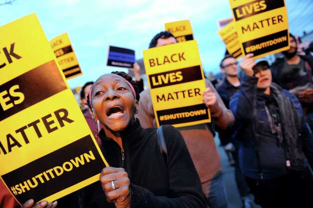 "Regina Burns of Albany chants ""Black lives matter"" during a rally outside Albany police south station on Friday, April 3, 2015, in Albany, N.Y. Citizens gathered to protest the death of Donald ""Dontay"" Ivy, the 39-year-old man who died after he was shocked with a stun gun and struggled with police. (Cindy Schultz / Times Union) Photo: Cindy Schultz / 00031291A"