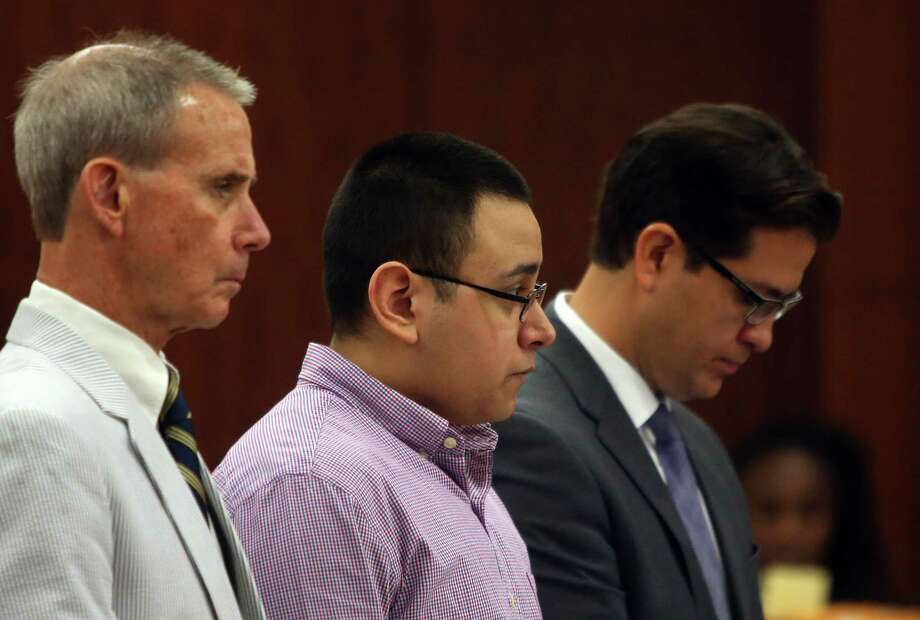 Victor Alas stands between defense attorneys Kurt Went and Mario Madrid while listening to charges in the 338th State District Court at the Harris County Criminal Courthouse on Sunday, June 14, 2015, in Houston. Alas is facing life without parole if convicted of capital murder of the 15-year-old Corriann Cervantes. Photo: Mayra Beltran, Houston Chronicle / © 2015 Houston Chronicle