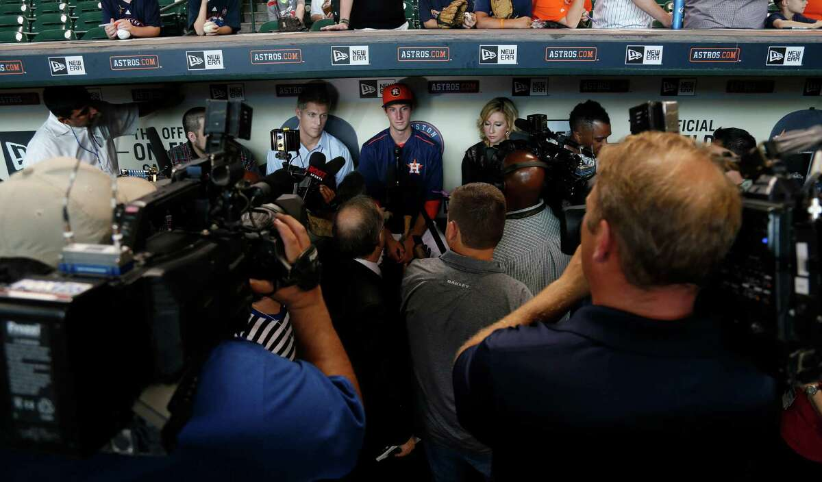 Newly signed outfielder Kyle Tucker, who was selected with the fifth-overall selection in the first round of the 2015 MLB First Year Player Draft, speaks to the media before the of an MLB game at Minute Maid Park on Monday, June 15, 2015, in Houston.