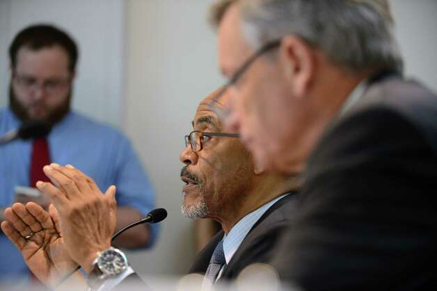 Regents member Lester W. Young, Jr., left, comments during a Board of Regents meeting as Anthony S. Bottar, vice chancellor of the state Board of Regents, right, listens Monday afternoon, June 15, 2015, at the State Education Building in Albany, N.Y. (Will Waldron/Times Union) Photo: WW