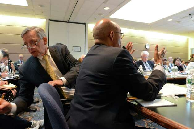 Anthony S. Bottar, vice chancellor of the state Board of Regents, speaks with an aide as Regents member Lester W. Young, Jr., right, comments during a Board of Regents meeting Monday afternoon, June 15, 2015, at the State Education Building in Albany, N.Y. (Will Waldron/Times Union) Photo: WW