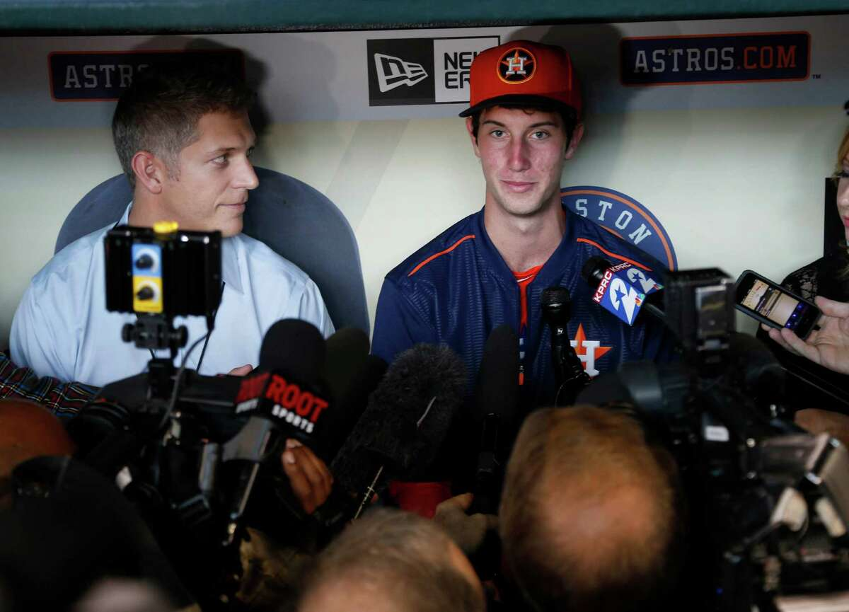 Newly signed outfielder Kyle Tucker, who was selected with the fifth-overall selection in the first round of the 2015 MLB First Year Player Draft, speaks to the media before the of an MLB game at Minute Maid Park on Monday, June 15, 2015, in Houston. ( Karen Warren / Houston Chronicle )
