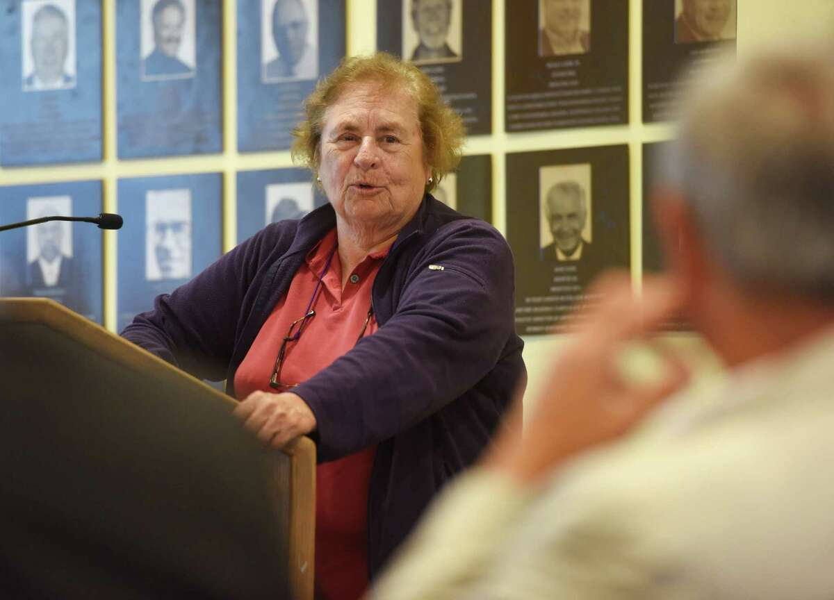 2015 inductee Angela Tammaro, longtime field hockey coach, lacrosse coach and athletic director at Greenwich Academy, speaks during the Fairfield County Sports Hall of Fame induction ceremony Monday at the University of Connecticut Stamford campus in Stamford.