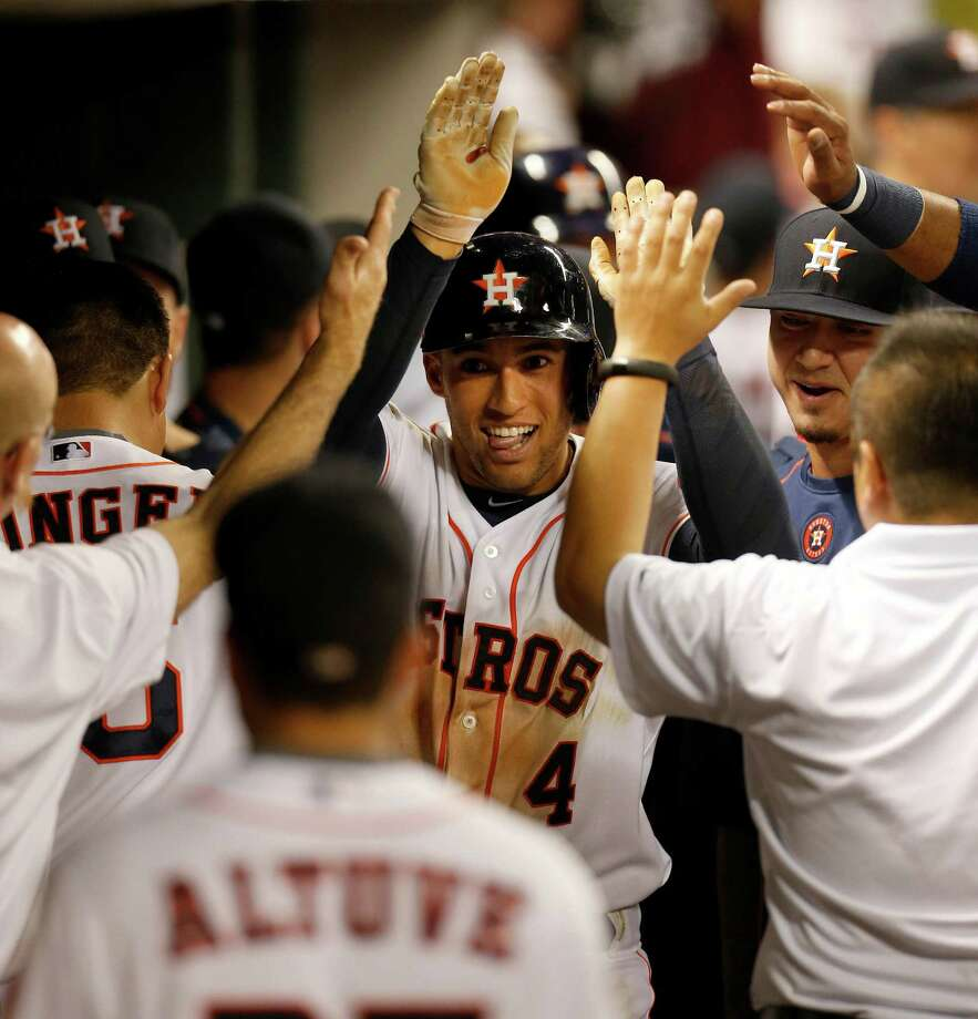 Astros right fielder George Springer is a hit in the dugout in the seventh inning Monday night after hitting his second home run of the game to go with two sensational catches. Photo: Karen Warren, Staff / © 2015 Houston Chronicle