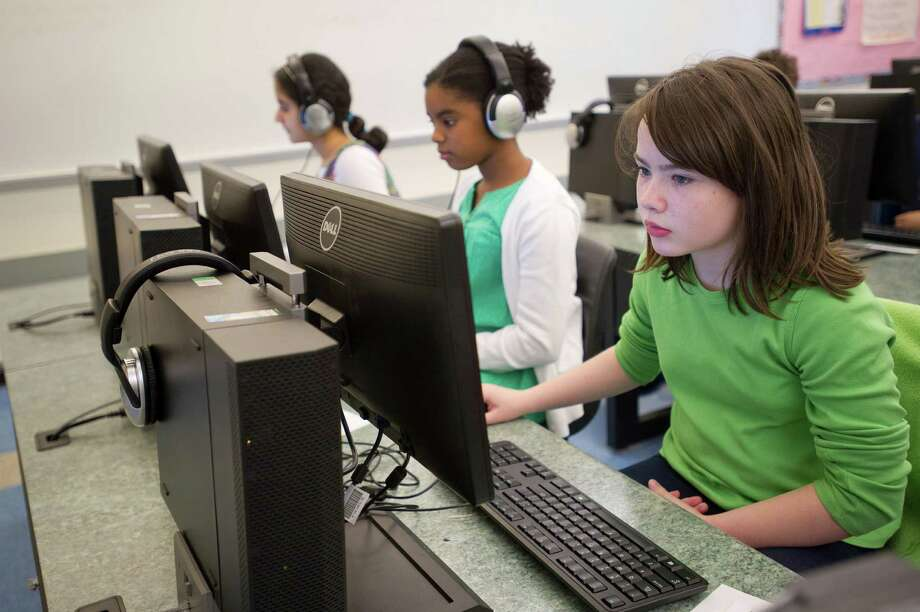 Hart Magnet School students, from left, Rhea Wadhwa, Zara Williamson and Ava Schmoelzer take a practice SBAC test in March. Photo: Lindsay Perry / Hearst Connecticut Media / Stamford Advocate