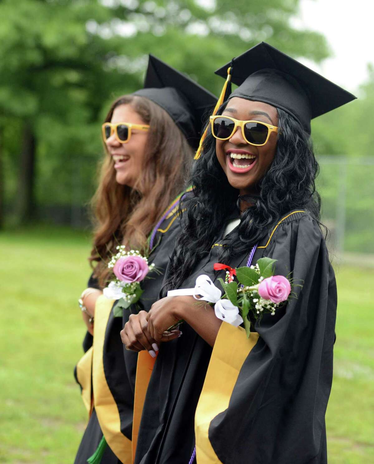 Imani Langston smiles as she walks onto the football field Monday for the Jonathan Law High School commencement at the school in Milford.