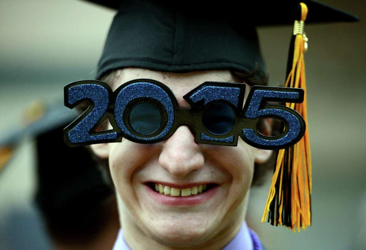 """Nick Beecher oversized """"2015"""" sunglasses Monday during the Jonathan Law High School commencement."""