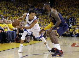 Golden State Warriors guard Stephen Curry, left, is guarded by Cleveland Cavaliers forward LeBron James during the second half of Game 5 of basketball's NBA Finals in Oakland, Calif., Sunday, June 14, 2015. (AP Photo/Ben Margot)