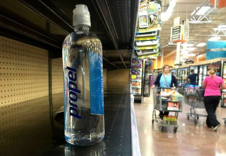 A bottle of water sits on a nearly empty shelf at a grocery store as residents around Houston quickly snatch up bottled water and other supplies on Monday. (June 16, 2015) Photo: Jason Fochtman, Associated Press