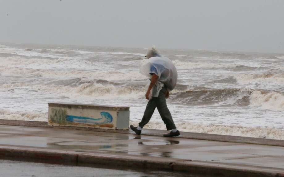 A man walks along Seawall boulevard in Galveston as Tropical Storm Bill approaches the Texas coast.  | Photo: James Nielsen | Houston Chronicle