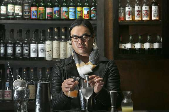 Bar manager Danny Louie of Mosto and Chino in San Francisco, California, makes a tomato salad cocktail on Monday, June 15, 2015.