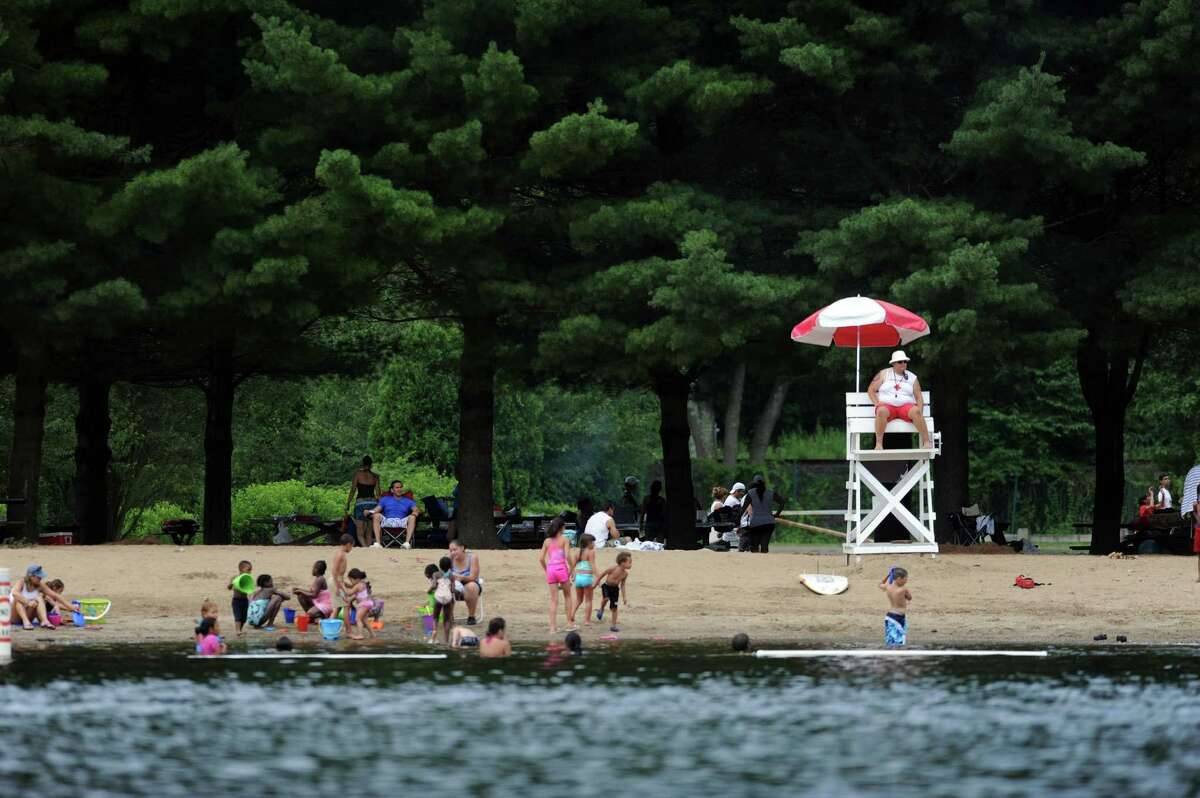 Beachgoers stay cool in the Housatonic River Saturday, July 7, 2012 at Indian Well State Park in Shelton, Conn.