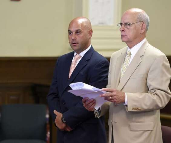 Former Troy police officer Brian Gross, left, pleads guilty in Rensselaer County Court on Tuesday, June 16, 2015, in Troy, N.Y.. With Gross is his attorney Steve Coffey. (Skip Dickstein/Times Union)