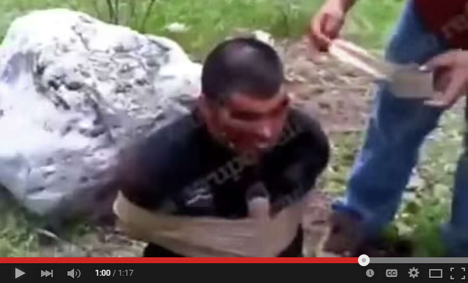 These images from a cellphone video purportedly show the New Generation Cartel killing a man and child by strapping dynamite to them and detonating the explosive. Photo: Youtube/Juan Herrera