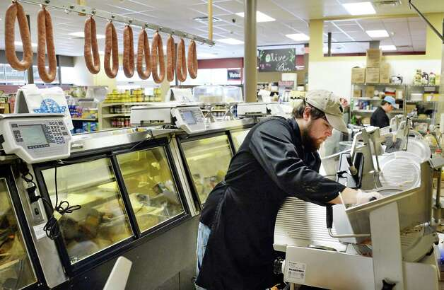 Alan Troumbley slices bologna at Fred the Butcher's deli counter Tuesday May 26, 2015 in Clifton Park, NY.  (John Carl D'Annibale / Times Union) Photo: John Carl D'Annibale / 00031954A