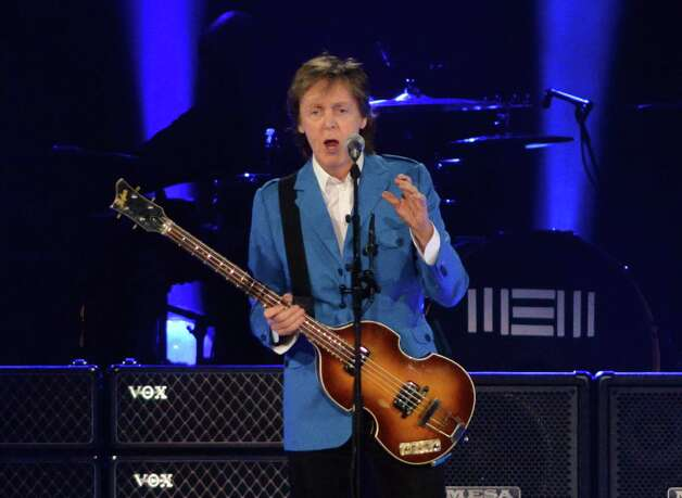 Paul McCartney addresses the audience during a performance at the Times Union Center Saturday July 5, 2014, in Albany, NY.  (John Carl D'Annibale / Times Union) ORG XMIT: MER2014070521224230 Photo: John Carl D'Annibale / 00027433A